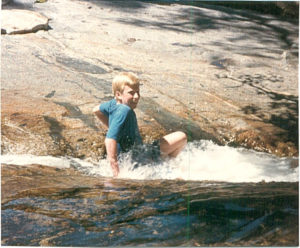 John in Northern Calfornia, playing in glacier fed stream, summer 1989